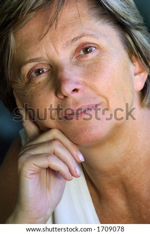 A portrait of a middleaged woman - stock photo