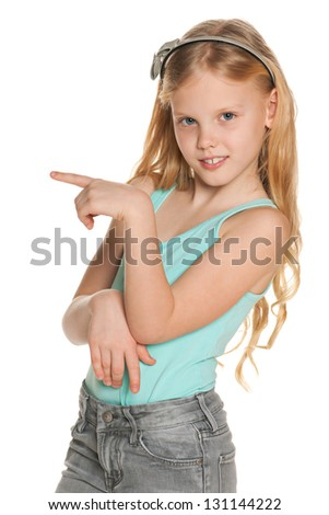 A portrait of a nordic girl in blue shirt shows the direction of her finger - stock photo