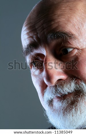 a portrait of a old man with surprised face