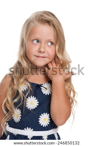 A portrait of a pensive little blonde girl against the white background