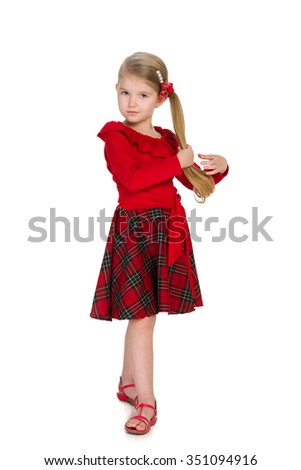 A portrait of a pretty little girl in a red dress on the white background