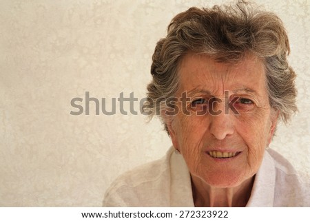 A portrait of a senior woman between 70 and 80 years old. Free space for a text. Vintage - stock photo