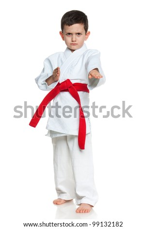 A portrait of a serious little boy in kimono; isolated on the white background