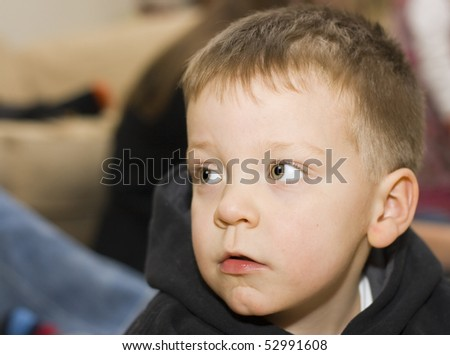 A portrait of a serious looking three year old boy - stock photo