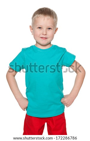 A portrait of a smiling little boy in blue shirt on the white background