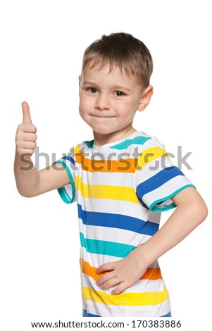A portrait of a smiling young boy holding his thumb up on the white - stock photo