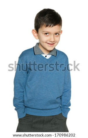 A portrait of a smiling young boy on the white background