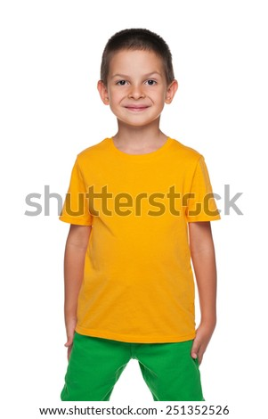A portrait of a smiling young boy on the white background - stock photo