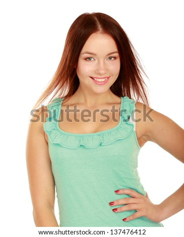 A portrait of a smiling young woman standing , isolated on white background - stock photo