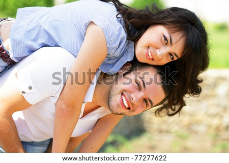 A portrait of a sweet couple in love embracing outdoors