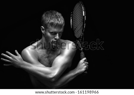 A portrait of a tennis player with a racket. - stock photo