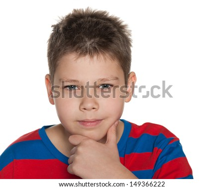 A portrait of a thinking boy on the white background - stock photo
