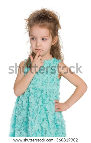 A portrait of a thinking little girl on the white background - stock photo