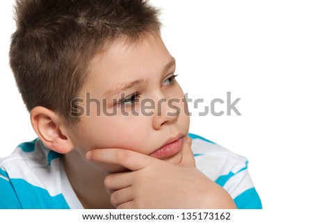 A portrait of a thoughtful boy looking aside; on the white background - stock photo
