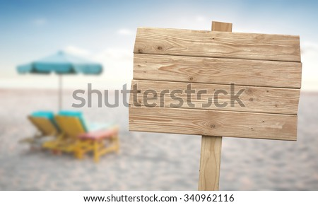 A portrait of a vintage rustic wooden sign on the beach - stock photo