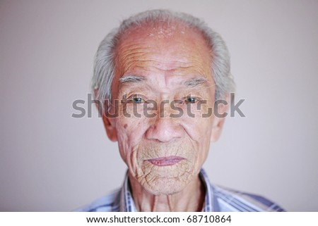 A portrait of a wrinkly old chinese man.