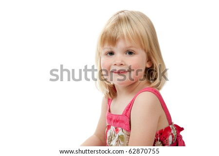 A portrait of a 4 year old girl.  She is wearing a red dress and is smiling.