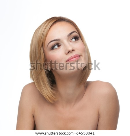 a portrait of a young, blonde woman, looking up, to the right, with a happy, daydream expression - stock photo