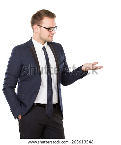 A portrait of a young businessman take something on his hand, concept isolated