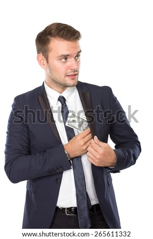 A portrait of a young businessman taking out money from his pocket - stock photo