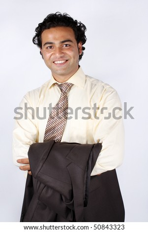 A portrait of a young Indian businesman, in a happy mood. - stock photo