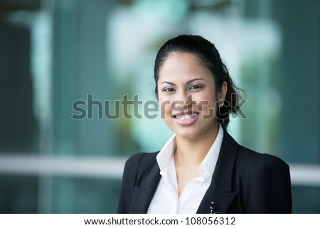 A portrait of a young Indian business woman at the office.