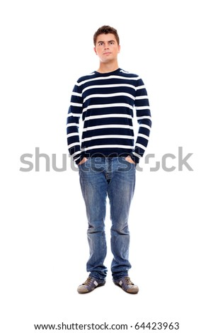 A portrait of a young man standing firmly with hands in pockets over white background