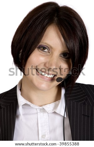 A portrait of a young professional woman in a black pinstripe suit with headphones and microphone on her head, isolated on white background. - stock photo