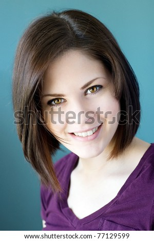 A portrait of a young smiling woman. - stock photo