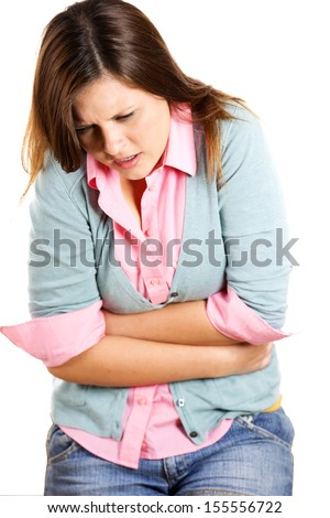 A portrait of a young woman having stomach ache isolated on a white background with copy space. Food poisoning, stomach flue, cramps. - stock photo