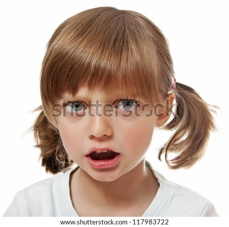 a portrait of an angry little girl - stock photo