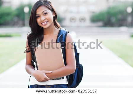 A portrait of an Asian college student at campus