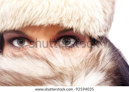 A portrait of an attractive woman wearing a fur hat