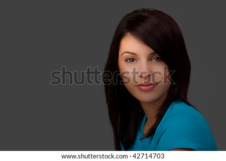 A Portrait of an attractive young woman with selective lighting. - stock photo