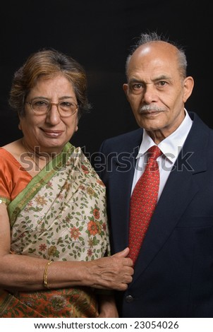A portrait of an elegant East Indian couple - stock photo