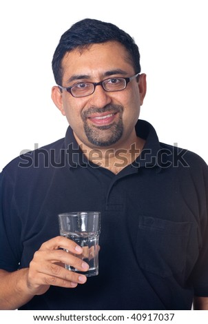 A portrait of an Indian man with a glass of water - isolated on white - stock photo
