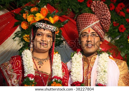 A Portrait Of An Indian Wedding Couple In Their Traditional Attire