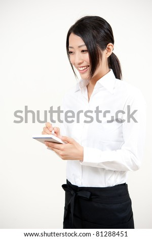 a portrait of asian waitress isolated on white background - stock photo