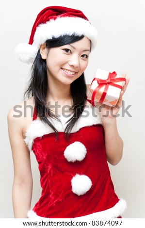 a portrait of attractive asian santa woman - stock photo