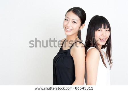 a portrait of attractive asian women standing - stock photo