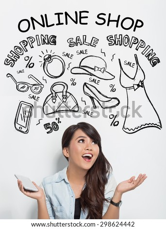 A portrait of beautiful asian woman holding a handphone while imagining about shopping online - stock photo