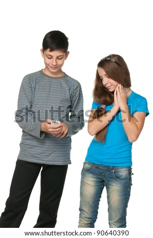 A portrait of fashion  teenagers with a cell phone; isolated on the white background - stock photo
