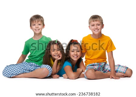A portrait of four happy children on the white background