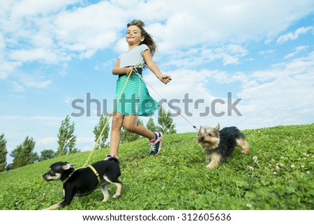 A portrait of girl keeping pretty dog outdoor