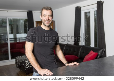 A Portrait of happy young man at home - stock photo