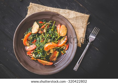 A portrait of Kale and tomato stir-fry, close up - stock photo