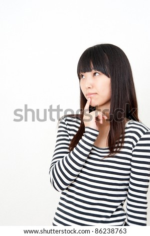 a portrait of pretty asian woman thinking - stock photo