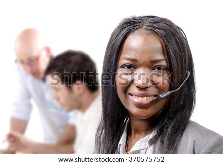 a portrait of smiling cheerful african support phone operator in headset.
