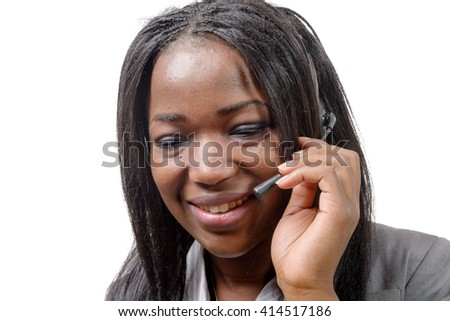 a portrait of smiling cheerful african support phone operator in headset. - stock photo