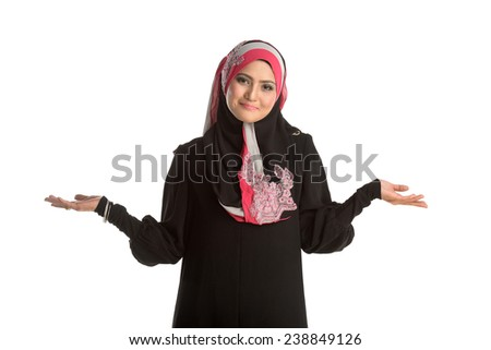 a portrait of young beautiful asian muslim woman show body language is nothing present in her hand. - stock photo